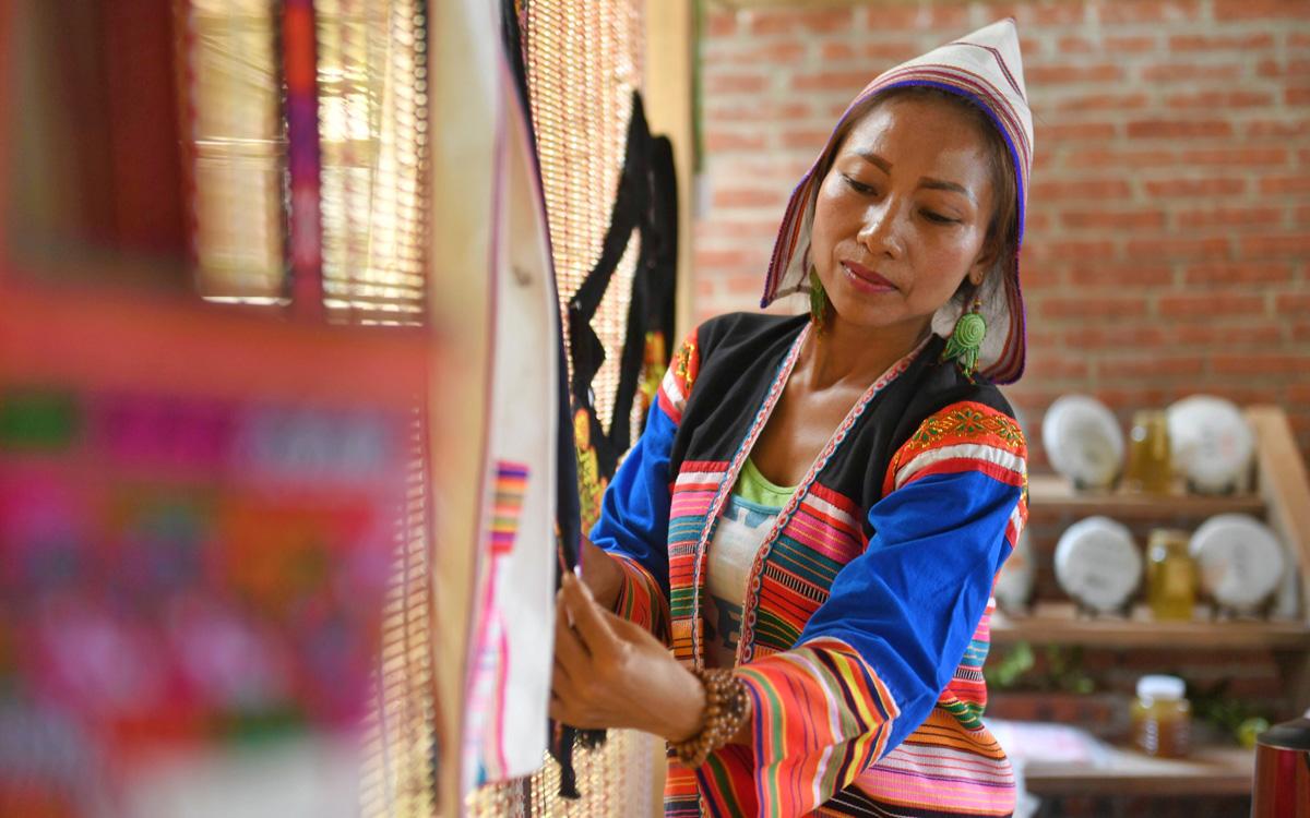 基諾族村民姿梅的農家樂致富經